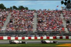Kamui Kobayashi, Sauber F1 Team F1 Team and Sergio Perez, Sauber F1 Team F1 Team