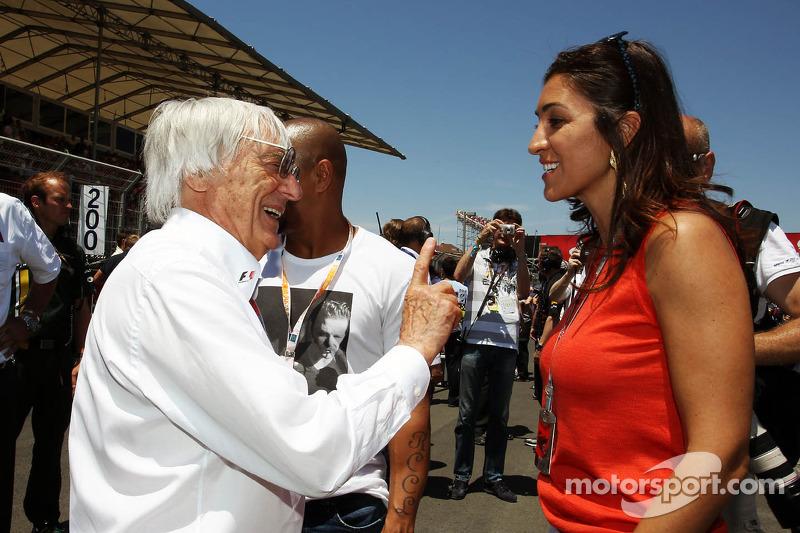 Roberto Carlos, Football Player met Bernie Ecclestone, CEO Formula One Group, en Fabiana Flosi