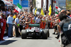 Third placed Michael Schumacher, Mercedes AMG F1 enters parc ferme