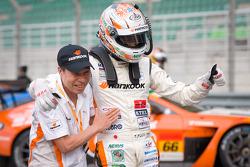 GT300 winner Tomonobu Fujii celebrates