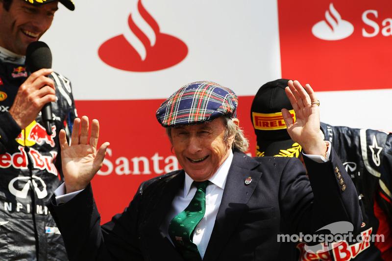 race winner Mark Webber, Red Bull Racing with Jackie Stewart, and Sebastian Vettel, Red Bull Racing on the podium