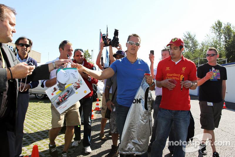 Michael Schumacher, Mercedes AMG F1 signs autographs for the fans