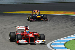 Fernando Alonso, Ferrari leads Sebastian Vettel, Red Bull Racing