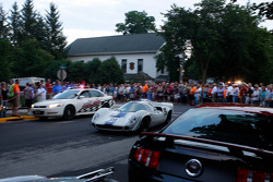 Race cars leave Elkhart Lake after the Friday Concours.