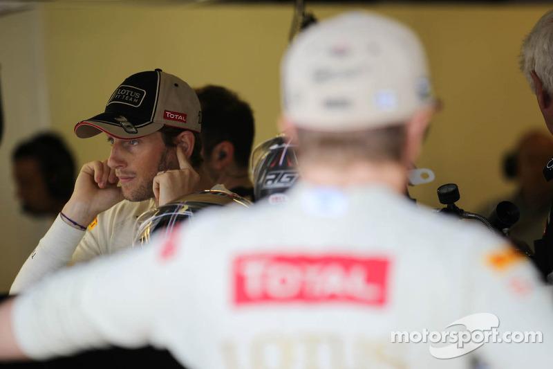 Romain Grosjean, Lotus F1 Team met Kimi Raikkonen, Lotus F1 Team