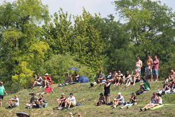 Fans on the grassy banks