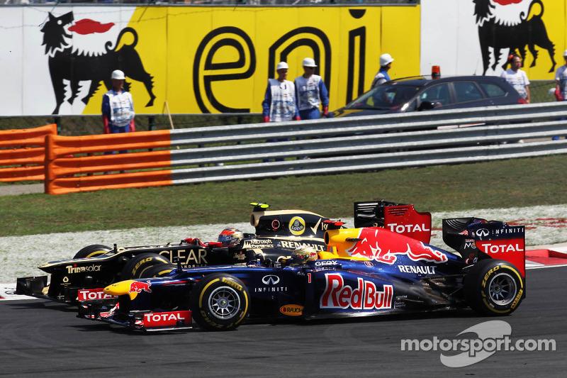 Romain Grosjean, Lotus F1 en Sebastian Vettel, Red Bull Racing duel