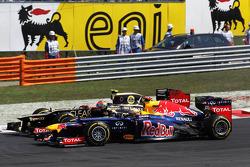 Romain Grosjean, Lotus F1 and Sebastian Vettel, Red Bull Racing battle for position at the start of the race