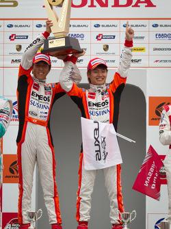 GT500 podium: winners Daisuke Ito and Kazuya Oshima