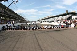 Race winner Jimmie Johnson, Hendrick Motorsports Chevrolet and his team kiss the yard of bricks