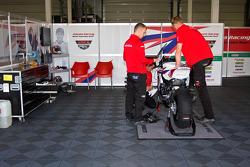 Mechanics work on the bike