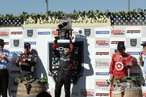 Victory lane: race winner Ryan Briscoe, second place Will Power, third place Dario Franchitti