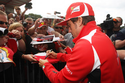 Fernando Alonso, Scuderia Ferrari signing autographs for the fans