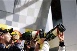 Race winner Jenson Button, McLaren celebrates on the podium with Sebastian Vettel, Red Bull Racing