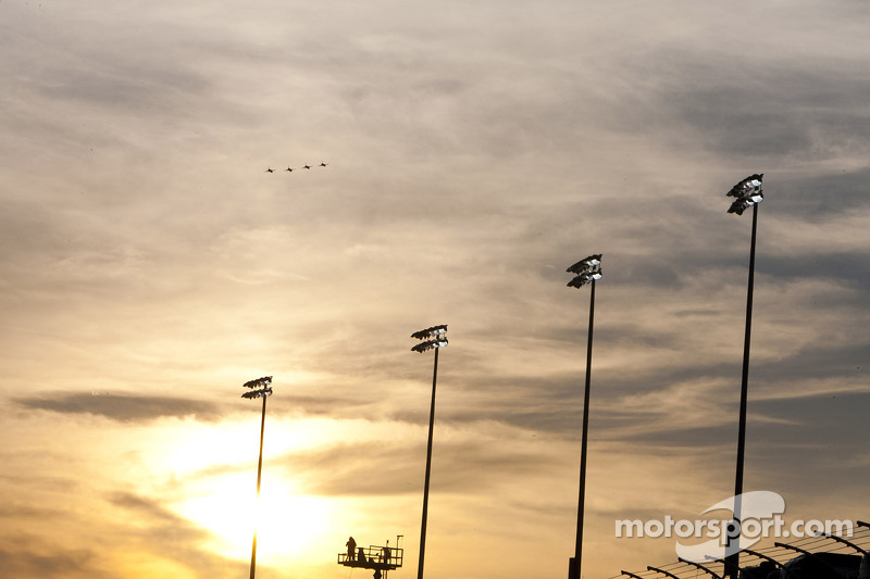The sun sets before the race