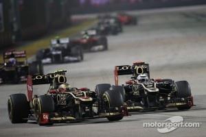 Romain Grosjean, Lotus F1 battles for position with his team mate Kimi Raikkonen, Lotus F1