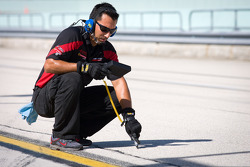 Technician checks track temperature