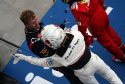 Kamui Kobayashi, Sauber celebrates his third position in parc ferme with race winner Sebastian Vettel, Red Bull Racing