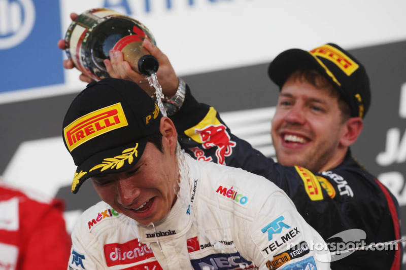 Kamui Kobayashi, Sauber celebrates his third position on the podium with race winner Sebastian Vettel, Red Bull Racing