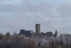 The Nürburg castle is covered in snow