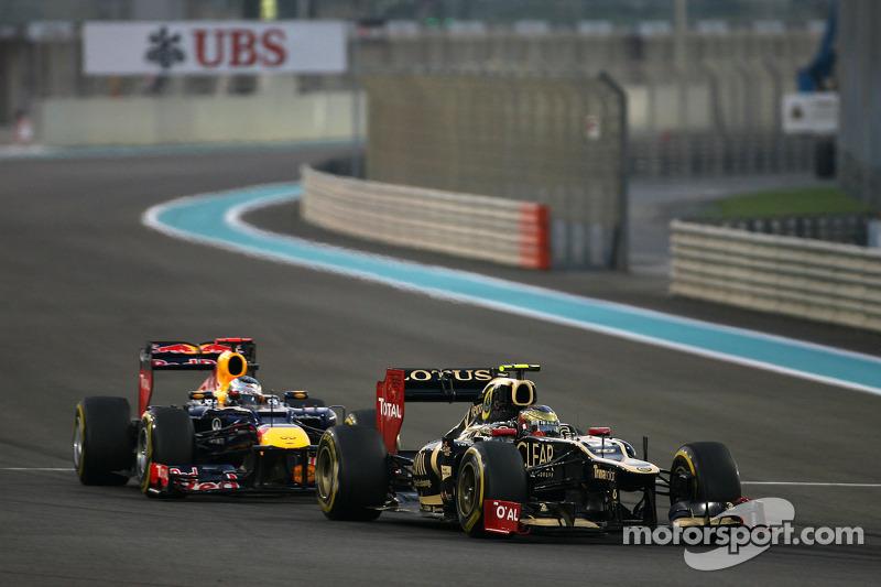 Romain Grosjean, Lotus F1 Team en Sebastian Vettel, Red Bull Racing