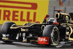 Race winner Kimi Raikkonen, Lotus F1 celebrates at the end of the race