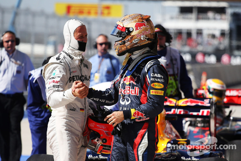 Sebastian Vettel, Red Bull Racing celebrates his pole position in parc ferme with Michael Schumacher