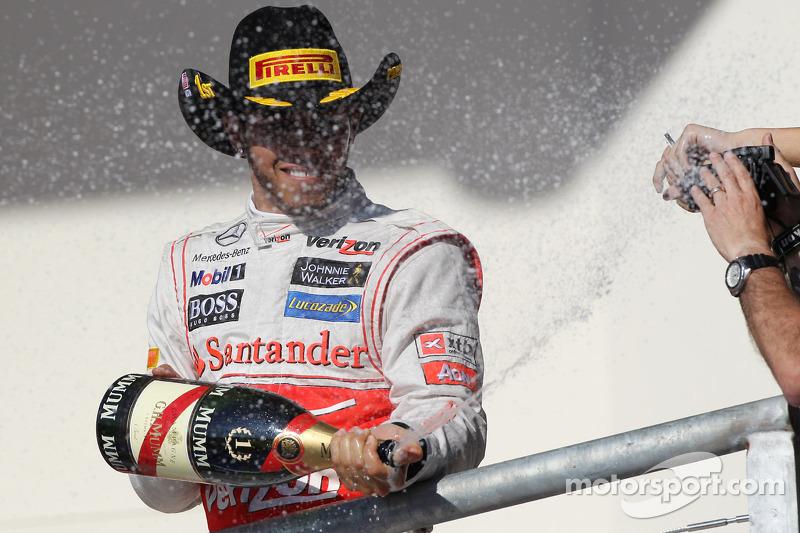 Race winner Lewis Hamilton, McLaren celebrates on the podium