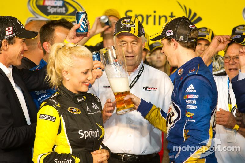 Championship victory lane: 2012 NASCAR Sprint Cup Series champion Brad Keselowski, Penske Racing Dodge celebrates with Roger Penske