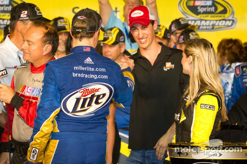 Championship victory lane: 2012 NASCAR Sprint Cup Series champion Brad Keselowski, Penske Racing Dodge congratulated by Joey Logano, Joe Gibbs Racing Toyota