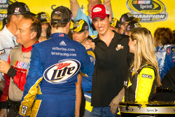 Championship victory lane: 2012 NASCAR Sprint Cup Series champion Brad Keselowski, Penske Racing Dodge congratulated by Joey Logano, Joe Gibbs Racing Toyota