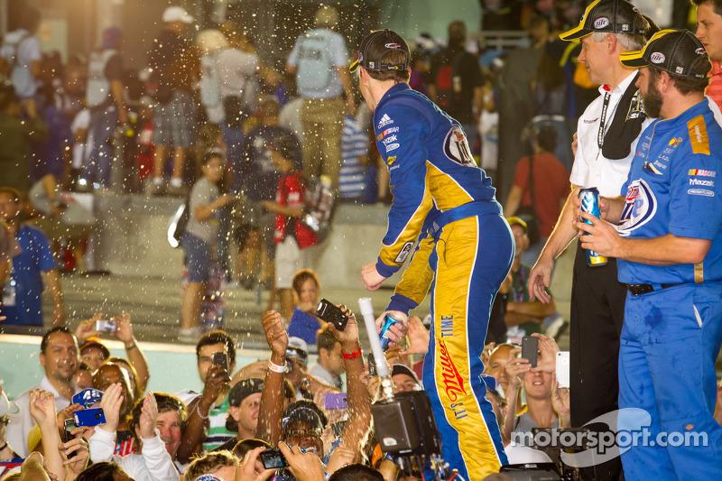 Championship victory lane: 2012 NASCAR Sprint Cup Series champion Brad Keselowski, Penske Racing Dodge sprays fans with beer