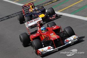 Fernando Alonso, Scuderia Ferrari leads Sebastian Vettel, Red Bull Racing during practice