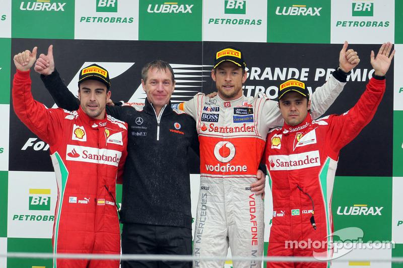 Podium: race winner Jenson Button, McLaren Mercedes, second place Fernando Alonso, Ferrari, third place Felipe Massa, Ferrari