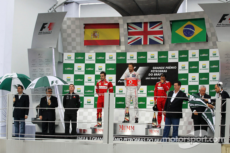 Podium: race winner Jenson Button, McLaren Mercedes, second place Fernando Alonso, Ferrari, third place Felipe Massa, Ferrari