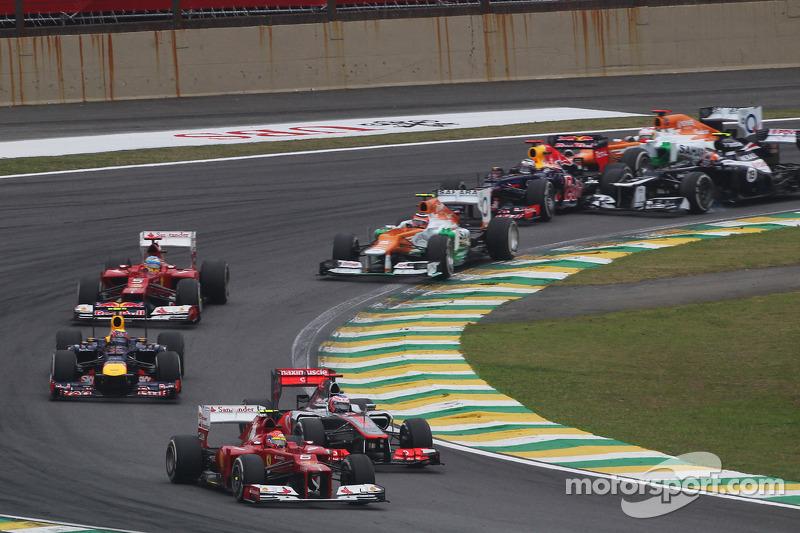 Felipe Massa, Ferrari leads Jenson Button, McLaren as Sebastian Vettel, Red Bull Racing survives a crash with Sergio Perez, Sauber and Bruno Senna, Williams at the start of the race
