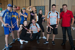 Ford and Holden drivers taking part in a challenge jumping rope