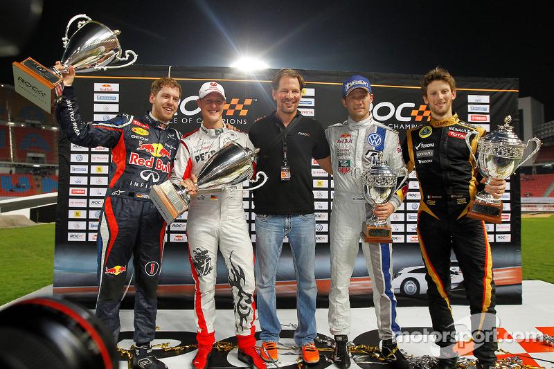 Second place Sébastien Ogier and Romain Grosjean with first place Sebastian Vettel and Michael Schumacher