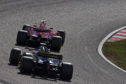 Kimi Raikkonen, Ferrari SF70H and Nico Hulkenberg, Renault Sport F1 Team RS17