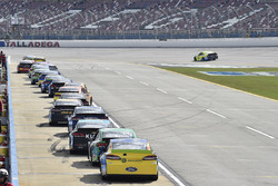 Cars sit in there penalty boxes during practice as Paul Menard, Richard Childress Racing Chevrolet goes buy