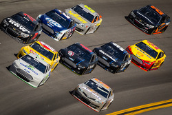 Casey Mears, Germain Racing Ford and Mark Martin, Michael Waltrip Racing Toyota lead a group of cars