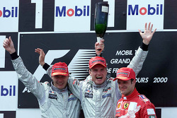 Podium: race winner David Coulthard, second place Mika Hakkinen, third place Rubens Barrichello