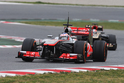 Jenson Button, McLaren MP4-28 leads Romain Grosjean, Lotus F1 E21