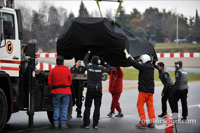 The Mercedes AMG F1 W04 of Lewis Hamilton, Mercedes AMG F1 is recovered back to the pits on the back of a truck