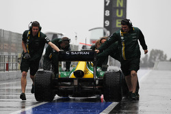 Charles Pic, Caterham CT03 is pushed back in the pits