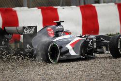 Nico Hulkenberg, Sauber C32 runs wide through the gravel trap