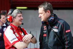 Steve Clark, Ferrari Chief Engineer with Steve Nielsen, Scuderia Toro Rosso Sporting Director