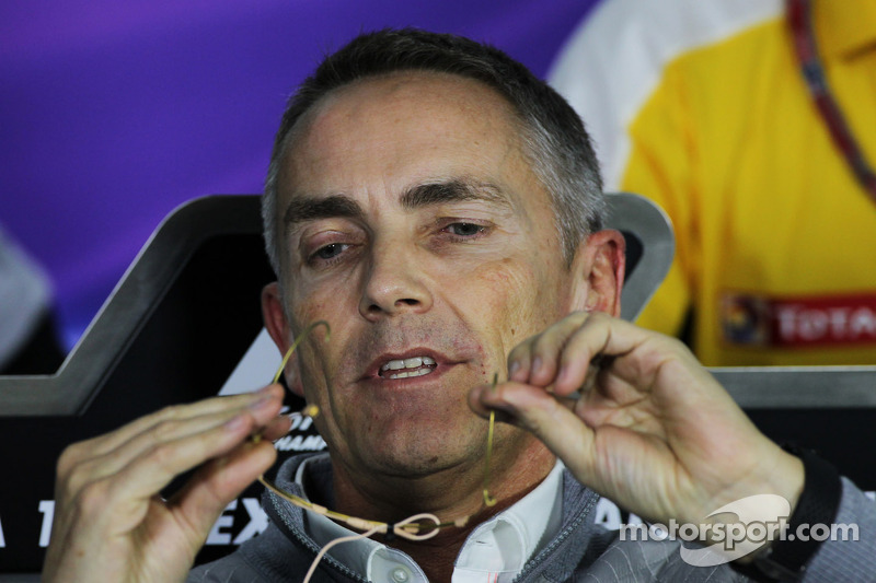 Martin Whitmarsh, McLaren Chief Executive Officer gets to grips with his microphone in the FIA Press Conference