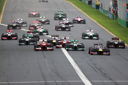Sebastian Vettel, Red Bull Racing RB9 leads at the start of the race