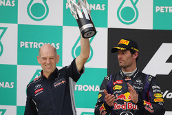Adrian Newey, Red Bull Racing Chief Technical Officer celebrates on the podium with Mark Webber, Red Bull Racing